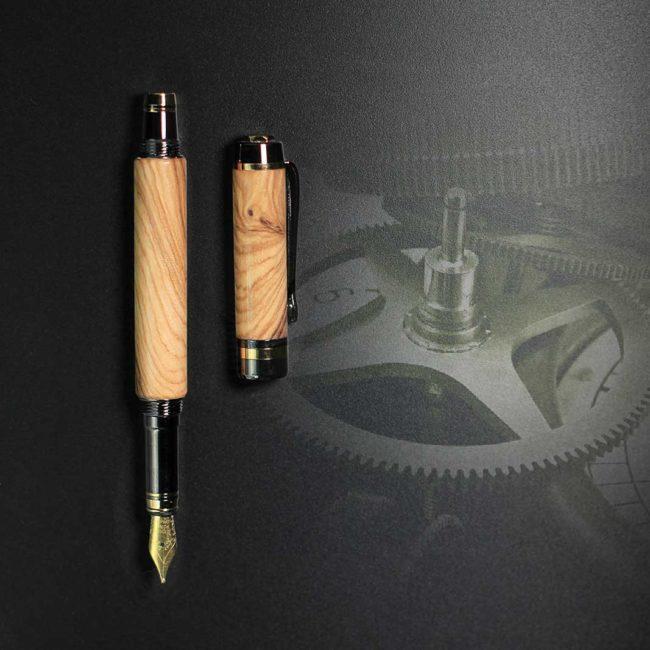Plume en bois d'Oliver Sauvage – appareil Or & Bronze